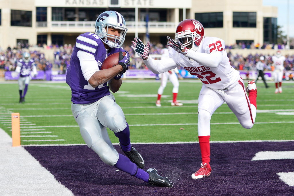 Nov 23, 2013; Manhattan, KS, USA; Kansas State Wildcats wide receiver Tyler Lockett (16) catches a pass for a touchdown while being defended by Oklahoma Sooners defensive back Cortez Johnson (22) during the first half at Bill Snyder Family Stadium. Mandatory Credit: Jasen Vinlove-USA TODAY Sports