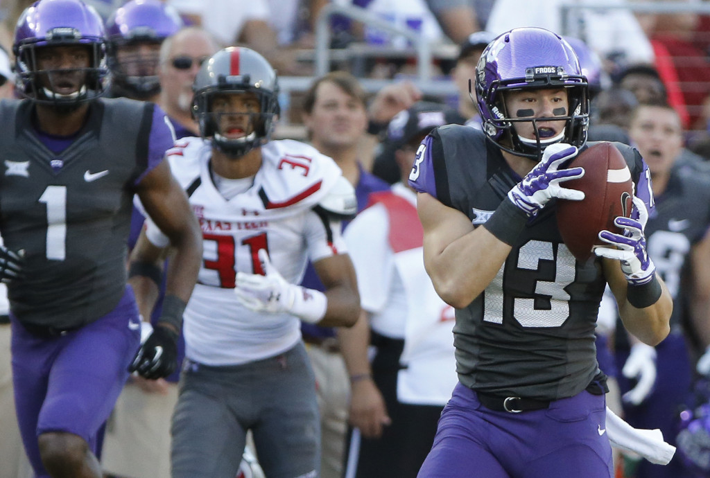 TCU receiver Ty Slanina (13) catches a third-quarter aerial and turns it into a touchdown as he outruns the Red Raider defense to the end zone during the Texas Tech University Red Raiders vs. the TCU Horned Frogs college football game at Amon G. Carter Stadium in Fort Worth on Saturday, October 25, 2014. (Louis DeLuca/The Dallas Morning News)