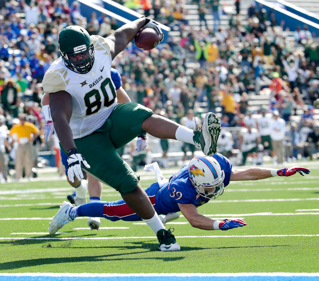 Baylor tight end LaQuan McGowan (80) gets past Kansas safety Michael Glatczak (39) to score a touchdown during the first half of an NCAA college football game Saturday, Oct. 10, 2015, in Lawrence, Kan. (AP Photo/Charlie Riedel)