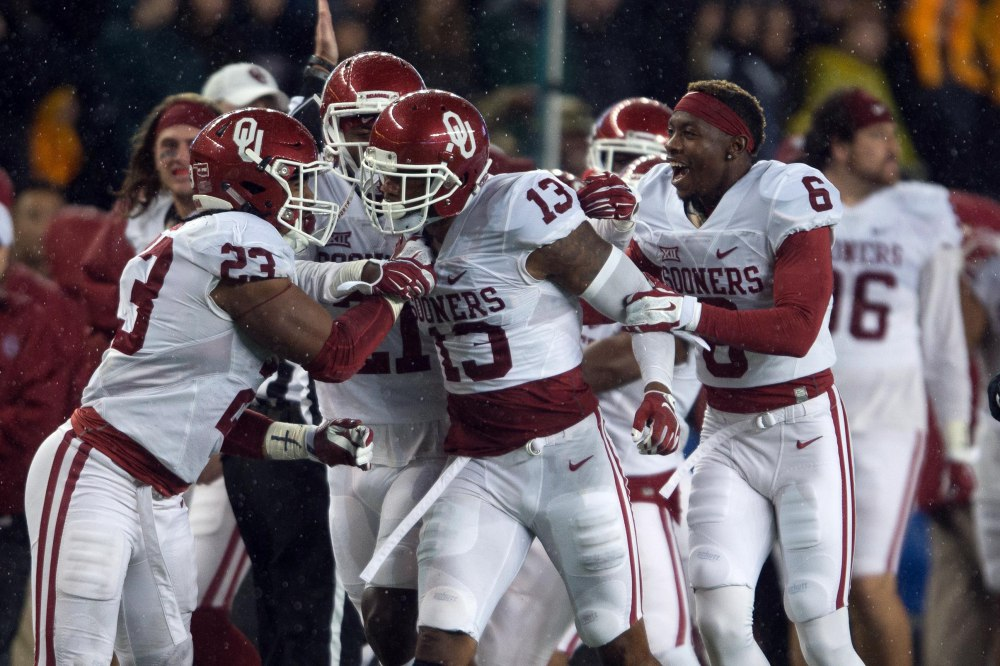 Nov 14, 2015; Waco, TX, USA; Oklahoma Sooners safety Ahmad Thomas (13) and linebacker Devante Bond (23) and cornerback Stanvon Taylor (6) celebrate the interception by Thomas against the Baylor Bears during the second half at McLane Stadium. The Sooners defeat the Bears 44-34. Mandatory Credit: Jerome Miron-USA TODAY Sports ORG XMIT: USATSI-227344 ORIG FILE ID: 20151114_pjc_an4_433.JPG