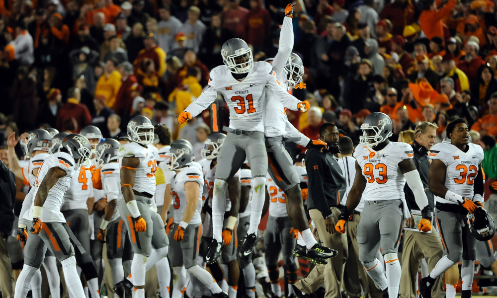Nov 14, 2015; Ames, IA, USA; Oklahoma State Cowboys safety Tre Flowers (31) celebrates a fourth down stop against the Iowa State Cyclones at Jack Trice Stadium. Oklahoma State defeated Iowa State 35-31. Mandatory Credit: Steven Branscombe-USA TODAY Sports ORG XMIT: USATSI-227346 ORIG FILE ID: 20151114_pjc_bc7_012.JPG