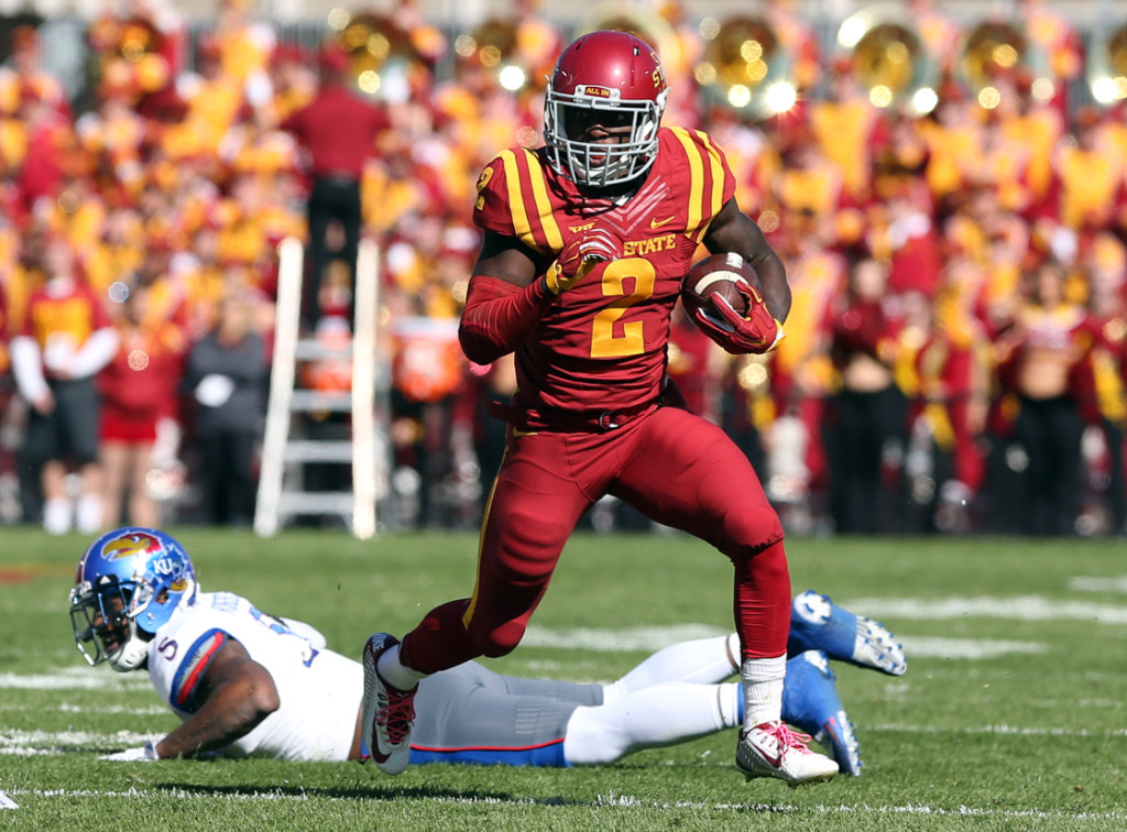 Oct 3, 2015; Ames, IA, USA; Iowa State Cyclones running back Mike Warren (2) runs for a first down against the Kansas Jayhawks at Jack Trice Stadium. Mandatory Credit: Reese Strickland-USA TODAY Sports