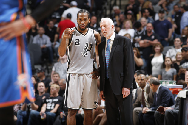 SAN ANTONIO, TX - MARCH 12: Kawhi Leonard #2 speaks with head coach, Gregg Popovich of the San Antonio Spurs during the game against the Oklahoma City Thunder on March 12, 2016 at AT&T in San Antonio, Texas. NOTE TO USER: User expressly acknowledges and agrees that, by downloading and or using this Photograph, user is consenting to the terms and conditions of the Getty Images License Agreement. Mandatory Copyright Notice: Copyright 2016 NBAE (Photo by Chris Covatta/NBAE via Getty Images)