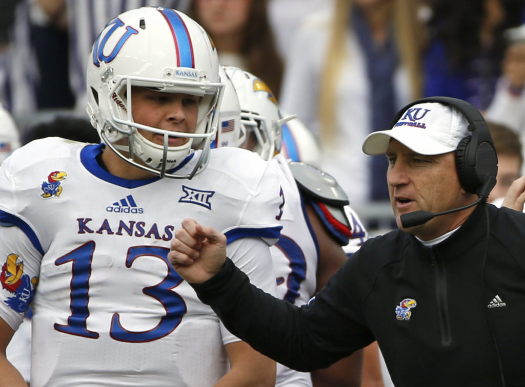 Kansas head coach David Beaty and quarterback Ryan Willis (13) work from the sidelines against TCU in the first half of an NCAA college football game Saturday, Nov. 14, 2015, in Fort Worth, Texas. (AP Photo/Ron Jenkins)