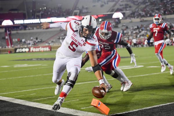 LUBBOCK, TX - SEPTEMBER 17: Quarterback Patrick Mahomes II #5 of the Texas Tech Red Raiders reaches for the pylon and scores a touchdown during the game Louisiana Tech Bulldogs on September 17, 2016 at AT&T Jones Stadium in Lubbock, Texas. Texas Tech won the game 59-45. (Photo by John Weast/Getty Images)