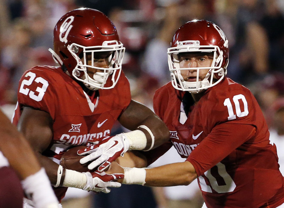 Oklahoma's Austin Kendall (10) hands off to Abdul Adams (23) during the second half of a college football game between the University of Oklahoma Sooners (OU) and Louisiana-Monroe (ULM) Warhawks at Gaylord Family-Oklahoma Memorial Stadium in Norman, Okla., on Saturday, Sept. 10, 2016. Photo by Steve Sisney, The Oklahoman