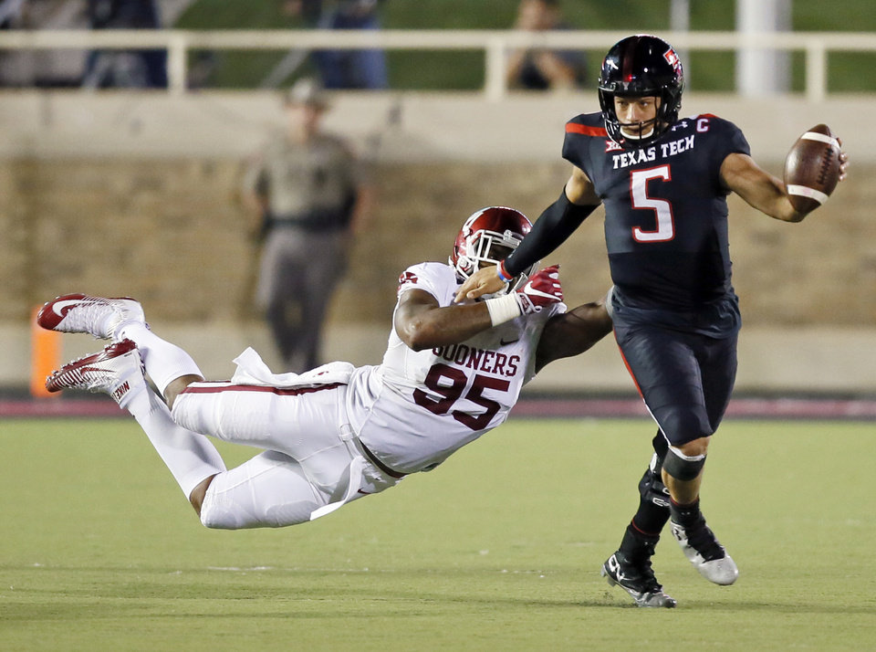 Texas Tech's Patrick Mahomes II (5) breaks away from Oklahoma's Austin Roberts (95) in the third quarter during a college football game between the University of Oklahoma Sooners (OU) and Texas Tech Red Raiders at Jones AT&T Stadium in Lubbock, Texas, Saturday, Oct. 22, 2016. OU won 66-59. Photo by Nate Billings, The Oklahoman
